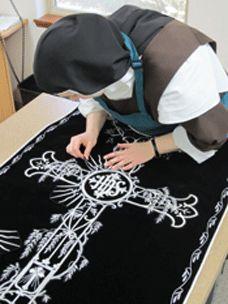 carmelite sister sewing ligurigcal vestment