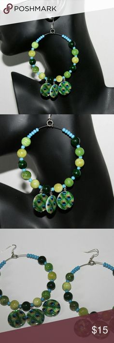 """Peacock beaded hoop earrings pierced or clip-on Handmade with glass beads & wire Measures 2.5"""" in width & hang 4.5"""" Available in pierced or clip-on Pet smoke free home Handmade Jewelry Earrings"""