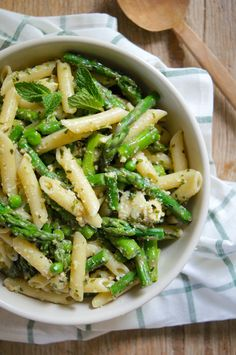 An easy vegetable pesto pasta that's as fresh and green as the the spring veggies that it's packed with. The pesto is made of equal parts basil and mint.