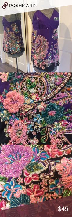 """Georgeous Embellished Tank Top NWOT This top is beautifully Embellished on the front side with beads highlighting the floral & paisley pattern. The pictures don't do the beading justice! Back is not beaded. There is a side zipper & adjustable shoulder straps. There are 6"""" slits at both sides at the hip for ease of movement. The back has modest elastic for extra give. Garment measured flat at chest is approx. 17"""". There are no tags so my guess is this would fit a small to medium depending on…"""