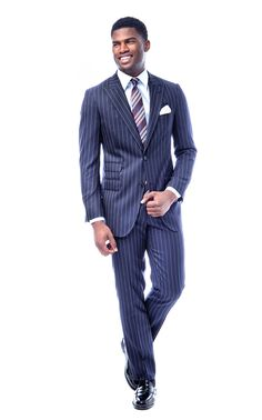 Nothing says Classic like a tailored pinstripe suit. This navy suit features a prominent white chalkstripe, foolproof for all your important business meetings. The jacket features a navy blue lining, contrasting red besom pockets and corozo nut buttons as standard. The pants are half-lined and come with a heel guard to protect against wear and tear.