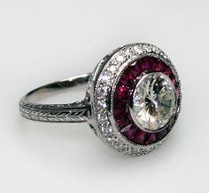 """""""Diamond and Ruby Engagement Ring  1930s    diamond and ruby engagement ring set in 18 carat gold. The diamond is approximately 2 carats."""""""
