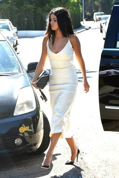 Selena Gomez in an all-white slip dress and black pumps - celebrity style