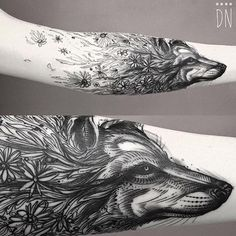 Wolf tattoo arm flowers ink style