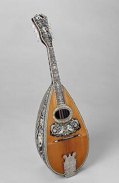 Mandolin  Angelo Mannello  (American, Morcone, Italy 1858–1922 New York)    Date:      ca. 1900  Geography:      New York, New York, United States  Medium:      Spruce, tortoiseshell, ivory, metal