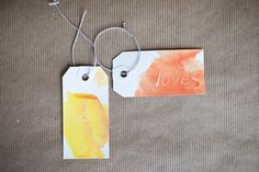 Project Design By: Victoria Hudgins  	Photos By: Carly Taylor  	Using watercolor in your wedding can be an easy way to add both color and pretty artistic flair. Make drink tags, escort cards, or favor labels with these easy instructions.  	   	  	   	Materials:  	You will need watercolor paints, paper tags, a white crayon, a paint brush and water.  	   	  	   	Process:  	Write in your details on the paper tag with a white crayon. I did a combo of...