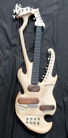 frettedchordophones: frettedchordophones: Mad Electric Harp Guitar Lardys Chordophone of the day - a year ago ==Lardys Chordophone of the day - 2 years ago --- https://www.pinterest.com/lardyfatboy/
