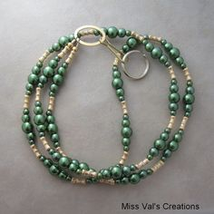 Green pearl lanyard. Use for your ID badge, transportation pass, keys and more! #lanyard #pearl #green