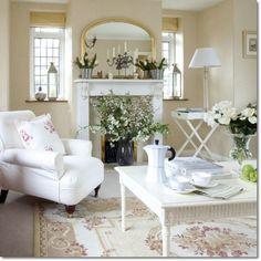 White furniture looks soft yet crisp against beige walls.