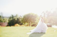 Lazaro wedding dress in that gorgeous golden light shot by Onelove Photography