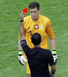Referee shows a red card to Poland's goalkeeper Szczesny during their Euro 2012 Group A match against Greece at the National Stadium in Warsaw