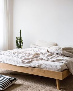Interior design simple minimalist bedding, wood bed frame, low bed frame simple apartment decor How Simple Apartments, Simple Bed Frame, Simple Bed, Wooden Bed Frames, Apartment Decor, Home, Simple Apartment Decor, Home Bedroom, Low Bed Frame