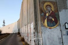 """Ian Knowles painted """"Our Lady Who Brings Down Walls"""" on the Israeli wall that divides Jerusalem from Bethlehem"""