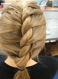 The twist braid is created with two sections.  To start, take two pieces and twist one over the other.  Add a piece of hair to the bottom section, and twist again!