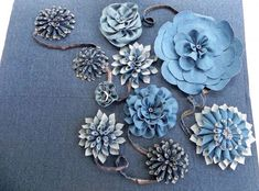 Denim Flowers -- no tutorial, but looks easy enough! These would look great on a pillow, purse, or skirt!