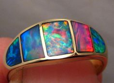 Solid 14k Yellow gold Ring inlaid with Gem Grade Crystal Opal from Lightning Ridge, Australia.