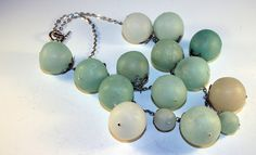 Hollow bead necklace made with Pardo Translucent and colored with alcohol inks. by Marilyn Davenport, aka Bits of Clay, via Flickr