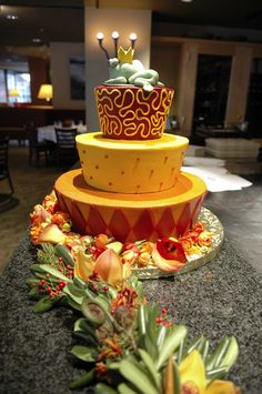 Fun yellow and orange wedding cake