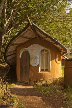 """""""Dawn/Dusk Duplex""""  Dude!!! The roof's a leaf!  Now that's where the tall fairies live.  I KNOW I want that roof for my potting shed and I bet @Michael Warren wants one too!"""