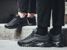 """This Nike Air Max 97 """"Triple Black"""" is basically dipped in all-black across its leather and textile mesh upper. Topping it off are reflective detailing atop its signature air bubble rubber sole. Air Max 97, Nike Air Max, Triple Black, Dark Grey, All Black Sneakers, Leather, Shoes, Fashion, Moda"""