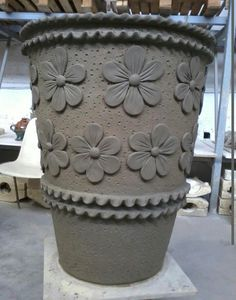 This vase has inspired me to add my personal touches when I DIY...I would use puffy flower stickers and then paint a reg. Terracotta a brighter color