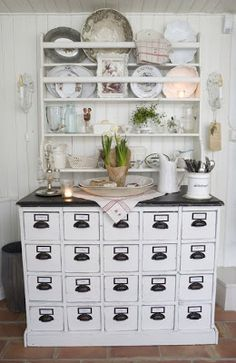 Antique apothecary cabinet turned buffet in this pretty #CottageHome .