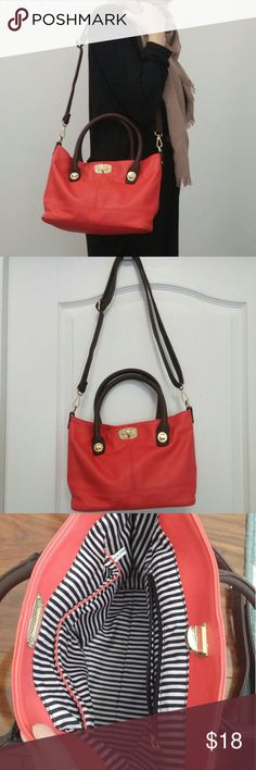 "Coral satchel cross body shoulder purse Like new bright coral hand bag with 13"" wide x 8"" tall. Gold hardware accents and removable shoulder or cross body strap. Handles are rich dark brown. No wear or stain marks in the exterior or interior stripped lining. Available in mint (see my profile) Price quite firm. 50% of proceeds go to charity. Bags Satchels"