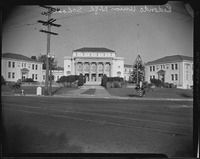 Redondo Union High School, Redondo Beach, [1920-1939?]Three main buildings of Redondo Union High School, Greek revival style building with 6 fluted ionic columns and capitals, flanked by 2-story side buildings with pediments, with lawn, walkway, and streets in foreground, with curb signs reading Elena Ave 200 Blk No and Diamond St. 500 Blk.