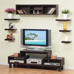 Living room, TV stand with shelving- storage without the huge console, which I fear would make our living room feel too small.