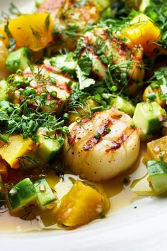 Here's a simple bright dish that's nearly effortless to put together. You make a sort of salad-like relish with onion, cucumber and golden beet, seasoned with ginger and lime juice. Once the scallops are grilled, you spoon the relish over and drizzle with fruity olive oil, along with a shower of chopped sweet herbs. Done and done. (Photo: Karsten Moran for The New York Times)