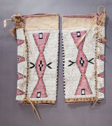 American Indian Art:Beadwork and Quillwork, A PAIR OF SIOUX WOMAN'S HIDE LEGGINGS. c. 1910... (Total: 2 )