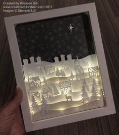 Kirsteen Gill This light-up frame piece uses the Hometown Greetings Edgelits and Card Front Builder thinlits and a set of led string lightsIt's big news when something breaks the mold and changes everything. The Stamparatus will change the way you st Christmas Shadow Boxes, Christmas Frames, Stampin Up Christmas, Noel Christmas, Ideas Decoracion Navidad, Xmas Lights, String Lights, Fairy Lights, Christmas Cards