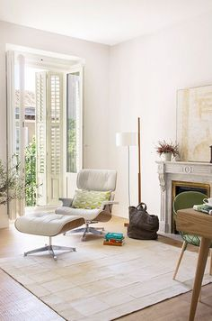 Tall French doors and stone fireplace neutral rug wooden floors ♥