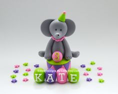 Edible Fondant Cake Toppers - Circus Animal - Elephant with stars and baby blocks.  via Etsy.