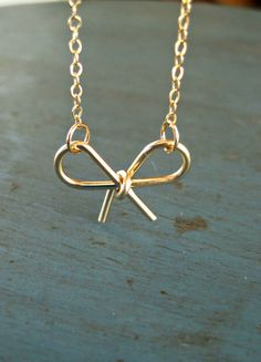 Gold Bow Necklace by vintagestampjewels on Etsy, $30.00