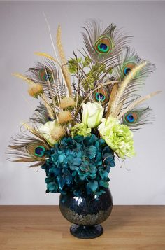 Teal Blue and Green Peacock Feather Hydrangea Floral Arrangement in Crackled Vase. $89.00, via Etsy.