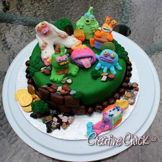 "This was a cake I made for my mom's birthday. She loves the ""My Singing Monster's"" game on her phone and plays it all the time. My daughter helped - she made the cute and colourful monster in the front!"