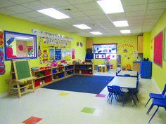 Sunshine Daycare Center's curriculum will emphasize reading, writing, math, and science skills, as well as fine and gross motor skills. Daycare Setup, Daycare Design, Home Daycare, Classroom Design, Classroom Decor, Daycare Ideas, Toddler Daycare Rooms, Daycare Spaces, Childcare Rooms