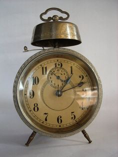 Old lovely alarm clock with numbers you can see,tocks' you to sleep and wakes even the deepest sleeper