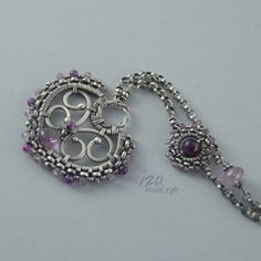 wire heart pendant with purple stones and chain
