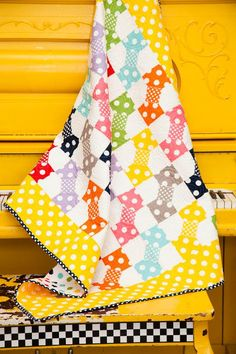 "The perfect project for your little loved one, the Polka Dot Patch Quilt Kit from Riley Blake is simply adorable. A quilt for all skill levels, you will love this quick project. With finished measurements of 40"""" x 46"""", this quilt is the sweet nursery accent you need!    #quilting #quilts #quiltkit"