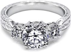 Tacori Three Stone Engagement Ring  : A delicate hand made Tacori engagement ring # 10943 featuring two round brilliant cut diamonds on either side of your choice of a center stone.