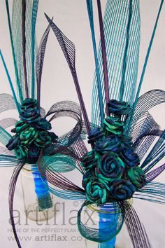 Paua (NZ abalone) inspired flax centrepieces with Artiflax flax flowers and authentic Hapene Flax.  Can be shipped all over the world, lasts a lifetime <3