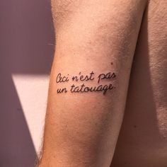 "Little handpoke tattoo saying ""Ceci n'est pas un tatouage"". Reference to the painter René Magritte! By The Lazy Factory (Meythet, France)."
