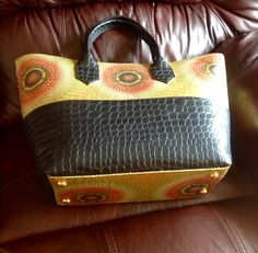 Beautiful sequined Ankara handbag. Great price @ $75. Will ship. Janeth_Okoronkwo@yahoo.com