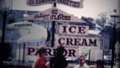 (8mm Vintage) Old Time Ice Cream Shop. http://www.pond5.com/stock-footage/49758702?ref=StockFilm keywords:16mm, 2160, 3840, 4k, 8mm, Americana, amateur, archive, cinematography, classic, clips, cuts, desert, edits, film, footage, golden age, grainy, home made, home movie, home video, ice cream, innocent, memories, nostalgia, old, preservation, projector, reel to reel, retro, romance, shop, super 8, treat, uhd, vintage