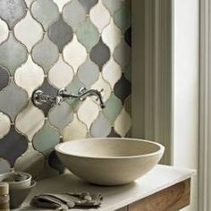 love the shape of the tiles- could be done as framed accent or all over &  in different color palettes
