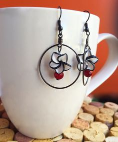 White flower dangly earrings by CraftingAwayTheFeels on Etsy