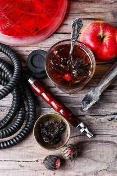 Hookah and tea Photos Cup of brewed herbal tea from rose and Turkish hookah by MLunov