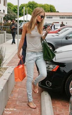 Striped sleeveless top, skinny pants and summer sandals.